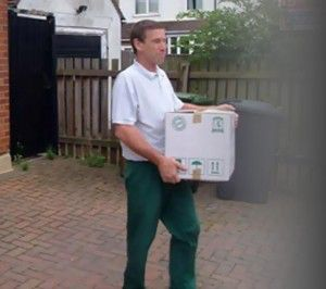 staff carrying boxes
