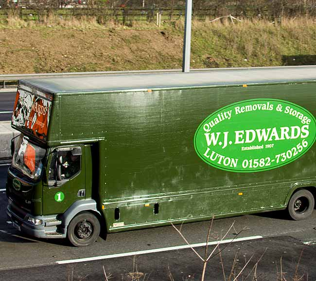 WJ Edwards removal lorry on road